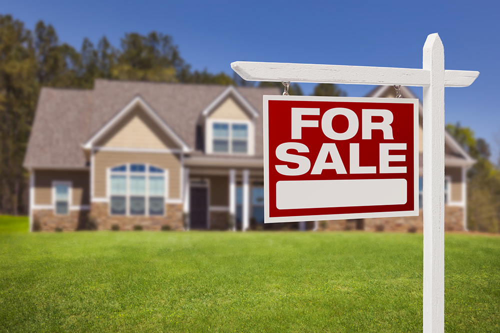 For sale sign in front of a house before home inspection services are provided