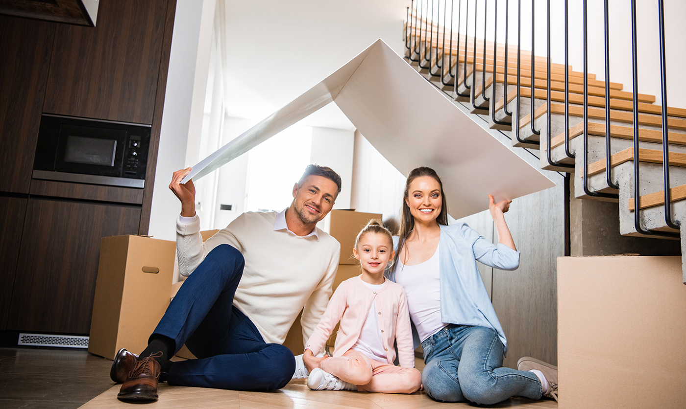 Happy family in their new house after a home inspection