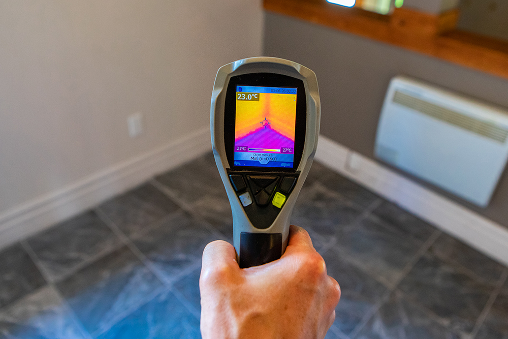 infrared thermal vision camera being used while preforming home inspection services